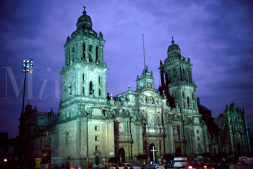 Exterior, evening view of the Metropolitan Cathedral on the Zocalo. Mexico City.