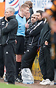 Alloa Manager Paul Hartley looks uninterested as he's spoken to by Referee Calum Murray.
