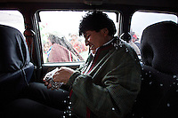 Oruro, Bolivia<br /> A picture dated January 12, 2015 shows Bolivianf President Evo Morales eating some dry meat inside an old car in his home town of Orinoca.