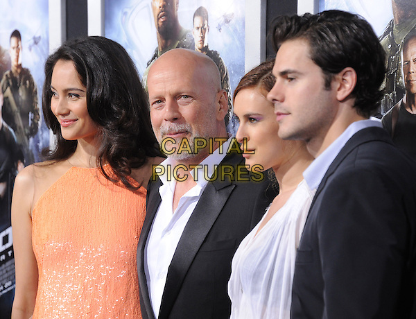 "Emma Heming, Bruce Willis, Rumer Willis & Jayson Blair.""G.I. Joe: Retaliation"" Los Angeles Premiere held at TCL Chinese Theatre, Hollywood, California, USA..March 28th, 2013     .half length beard facial hair black white shirt suit orange coral married husband wife dress shiny gold blouse side profile daughter father dad couple .CAP/DVS.©DVS/Capital Pictures."