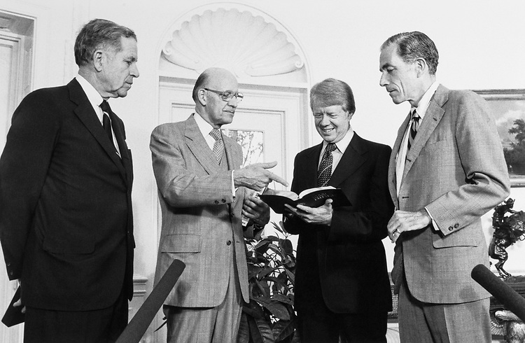 Sen. Claiborne Pell, D-R.I., standing with party members. (Photo by CQ Roll Call)