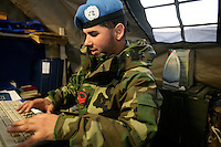An Italian soldier from the Montebello Squadron, Fifth  Lancieri of Novara regiment of the Italian Cavalry attends his duties as an administrator in the UNIFIL Chama base in Southern Lebanon on Friday Dec 08 2006..Close to 1000 Italian peacekeepers operate in  the in Southern lebanon town of Chama, constantly patrolling their sector in search for illegal weapons in the country.