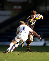 Sam Jones of London Wasps is tackled by Dan Braid of Sale Sharks during the Aviva Premiership match between London Wasps and Sale Sharks at Adams Park on Saturday 1st March 2014 (Photo by Rob Munro)