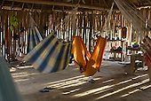 Xingu Indigenous Park, Mato Grosso State, Brazil. Aldeia Tuba Tuba (Yudja). Hammocks in the evening; ISA house.