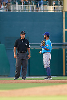 Umpire Jose Matamoros talks with Ivan Castillo (2) during a Texas League game between the Amarillo Sod Poodles and Frisco RoughRiders on July 13, 2019 at Dr Pepper Ballpark in Frisco, Texas.  (Mike Augustin/Four Seam Images)