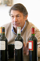 Michel Julien. Chateau, L'Opera and La Syrah. Chateau Villerambert-Julien near Caunes-Minervois. Minervois. Languedoc. Owner winemaker. France. Europe. Bottle.