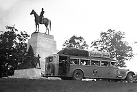"A ""Parkhill Tours"" tour bus parked near a civil way monument at the Gettysburg Battlefield , Gettysburg, PA, in 1930's America.  (photo by bcpix.com)"