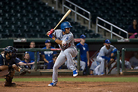 AZL Dodgers third baseman Leonel Valera (23) at bat in front of catcher Felix Fernandez (9) during an Arizona League game against the AZL Indians 2 at Goodyear Ballpark on July 12, 2018 in Goodyear, Arizona. The AZL Indians 2 defeated the AZL Dodgers 2-1. (Zachary Lucy/Four Seam Images)