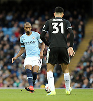 Manchester City's Fernandinho threads a pass despite the attentions of Burnley's Dwight McNeil<br /> <br /> Photographer Rich Linley/CameraSport<br /> <br /> Emirates FA Cup Fourth Round - Manchester City v Burnley - Saturday 26th January 2019 - The Etihad - Manchester<br />  <br /> World Copyright © 2019 CameraSport. All rights reserved. 43 Linden Ave. Countesthorpe. Leicester. England. LE8 5PG - Tel: +44 (0) 116 277 4147 - admin@camerasport.com - www.camerasport.com