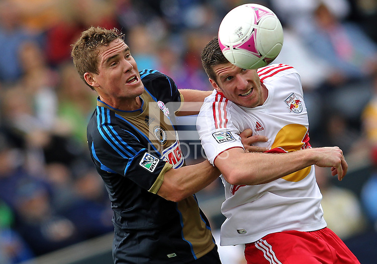 CHESTER, PA - OCTOBER 27, 2012:  Chris Albright (3) of the Philadelphia Union goes for a high ball with  Kenny Cooper (33) of the New York Red Bulls during an MLS match at PPL Park in Chester, PA. on October 27. Red Bulls won 3-0.