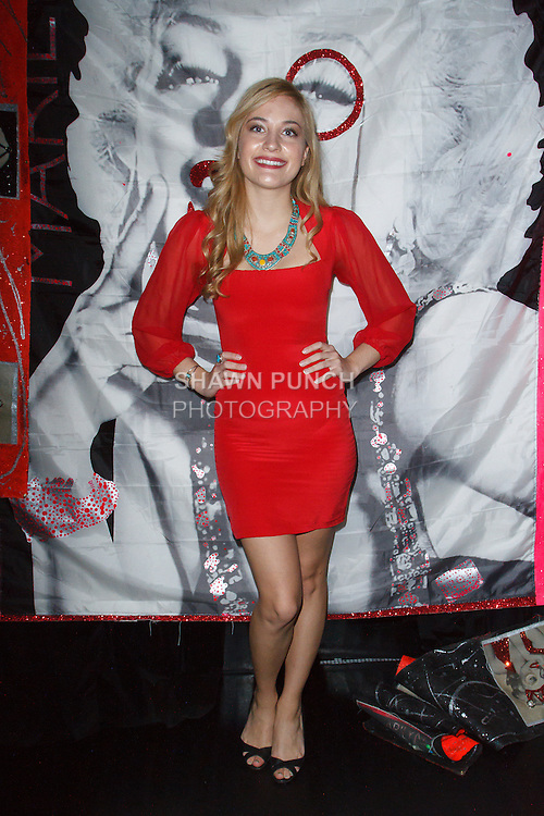 Guest poses in front photo booth, during the Art of Persuasion event at Beautique on 8 West 58 Street, in New York City on November 19, 2016.