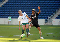 FC Gold Pride forward Marta (10) pressures Red Stars defender Whitney Engen (9).  The FC Gold Pride defeated the Chicago Red Stars 3-2 at Toyota Park in Bridgeview, IL on August 22, 2010