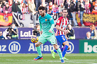 Leo Messi of Futbol Club Barcelona competes for the ball with Diego Godin of Atletico de Madrid  during the match of Spanish La Liga between Atletico de Madrid and Futbol Club Barcelona at Vicente Calderon Stadium in Madrid, Spain. February 26, 2017. (ALTERPHOTOS) /NortEPhoto.com