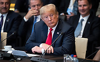 11 July 2018, Brussels, Belgium: Donald Trump, President of the United States of America,  sits at the first work session of the North Atlantic council at the NATO Summit. From 11 July 2018 until 12 July 2018 government heads of the 29 NATO member states and European Union representatives, will participate in the Summit of the North Atlantic Treaty Organization. Photo: Bernd von Jutrczenka/dpa /MediaPunch ***FOR USA ONLY***