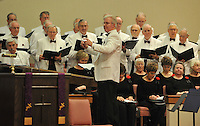 """NWA Media/Michael Woods --12/14/2014-- w @NWAMICHAELW...Conductor Bill Hesse (center) leads members of the Bella Vista Mens Chorus during Sunday afternoons Christmas Concert at the Bella Vista Community Church in Bella Vista.  The Bella Vista Mens Chorus presented """"I'm Dreaming of a Bella Vista Christmas"""" featuring classical, contemporary and gospel Christmas music under the direction of Bill Hesse and accompanied by Marilyn Lee on the piano. Also featured were the Village Handbell Ringers, under the direction of Marjorie Hemphill-Salomo and the Bella Vista Women's Chorus under the direction of Larry Zehring."""