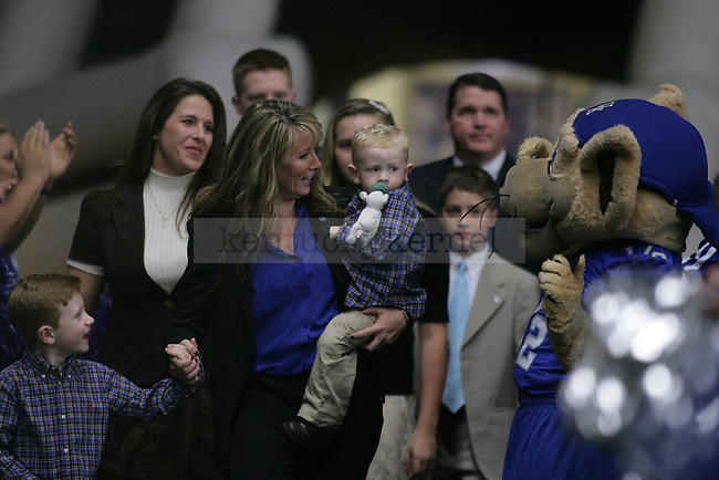 Mark Stoops wife, Chantel, and sons Will and Zack, make their way into the Live Press Conference held at the Nutter Training Facility in Lexington, KY on Sunday December 2nd, 2012. Photo by Kirsten Holliday | Staff