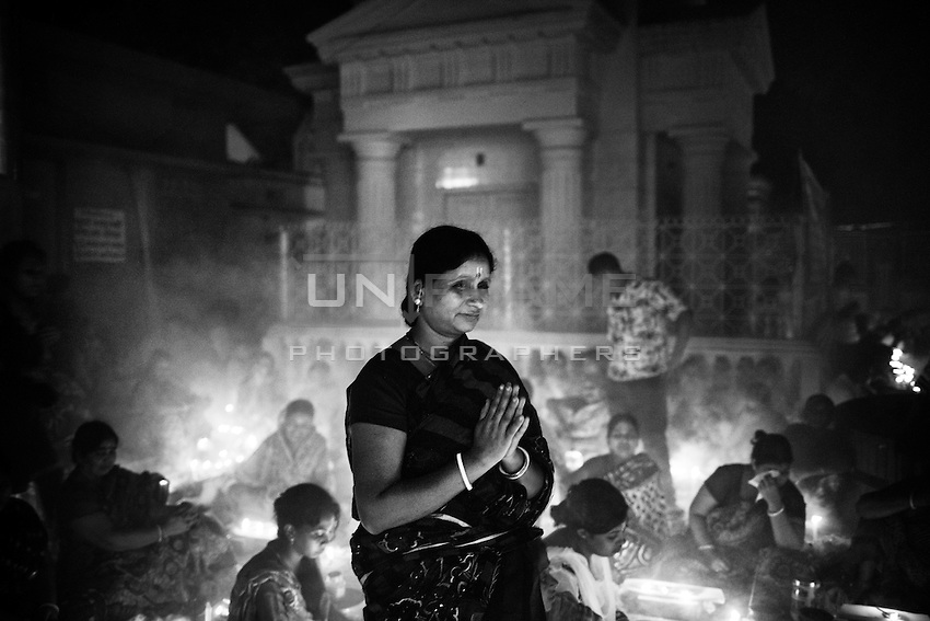 During Kartik, &ldquo;the holiest month&rdquo; beginning every year with the new moon in November, thousands of Hindu devotees celebrate the feast of Rakher Upobash, fasting and praying the gods sitting before the Shri Shri Lokanath Brahmachari Ashram, among the Swami Bagh Temple near Dhaka, Bangladesh. The worshippers offer candles called Prodip, meditate, give to charity, and generally perform austerity. <br /> The faithful pray while thick clouds of incense raise into the air.<br />  Barodi, Dhaka, Bangladesh. Nov. 08, 2014