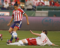 Red Bulls Def. Taylor Graham Slide tackles Chivas USA Forward & Captain Juan Francisco Palencia during a 0-0 tie between Chivas USA vs New york Red Bulls in a MLS game at The Home Depot Center in Carson, California Saturday, April, 29, 2006.