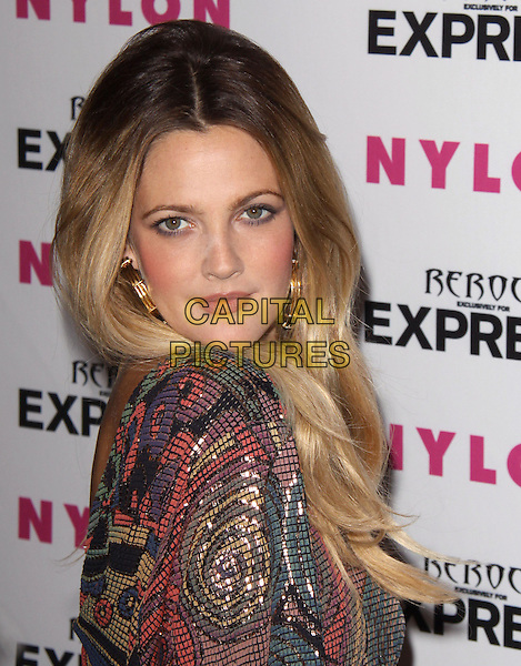DREW BARRYMORE.at the NYLON + EXPRESS August Denim Issue party held at The London in West Hollywood, California, USA, August 10th 2010..portrait headshot  green gold red multi-coloured patterned chainmail chain mail side .CAP/RKE/DVS.©DVS/RockinExposures/Capital Pictures.