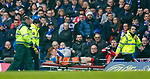David Bates stretchered off by Darren Miller and his St Andrew's first aider team at Ibrox after an accidental challenge by Tom Rogic