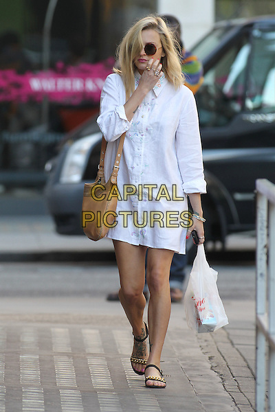Fearne Cotton in central London, England..July 23rd, 2012.full length white shirt dress beige bag purse satchel sunglasses shades open toe sandals plastic carrier shopping bag hand arm.CAP/HIL.©John Hillcoat/Capital Pictures.