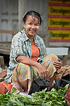 A woman in the Tahan Market in Kalay, a town in Myanmar. This market is located in Tahan, the largely ethnic Chin section of the town. She thanaka, a cosmetic paste, on her face.