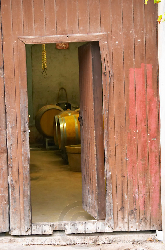 Domaine Entretan, J-C and D Plantade in Roubia. Minervois. Languedoc. A door. The winery building. France. Europe.