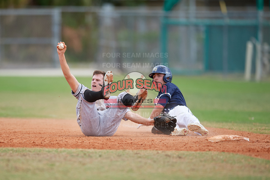 Edgewood Eagles starting pitcher Ryan Fields (9) shows the ball after getting Nick Wibben (4) out at first base during the second game of a double header against the Bethel Wildcats on March 15, 2019 at Terry Park in Fort Myers, Florida.  Bethel defeated Edgewood 3-2.  (Mike Janes/Four Seam Images)