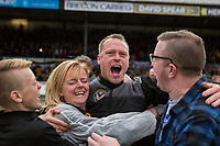 Newport County manager Mike Flynn celebrates his side's win on the pitch at full time during the Sky Bet League 2 match between Newport County and Notts County at Rodney Parade, Newport, Wales on 6 May 2017. Photo by Mark  Hawkins / PRiME Media Images.