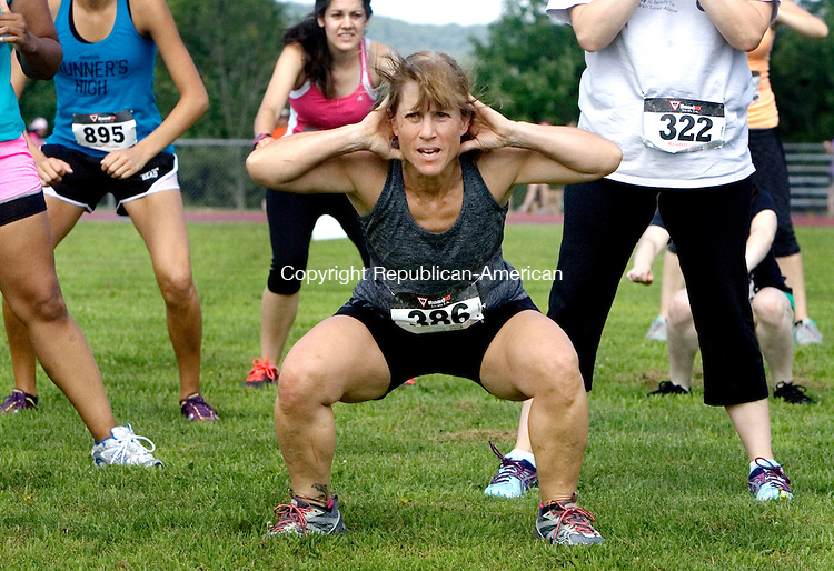 WINSTED CT. 01 August 2015-080115SV01-Mandy Hill of Torrington does some calisthenics at the start of the 2nd Annual Stronger Women, Stronger World 5K Obstacle Challenge<br /> at Northwestern Regional High in Winsted Saturday. The event benefits the Susan B. Anthony Project, the Northwest CT YMCA Girls Sports Initiative, CHH's Pink Rose Fund and The Women and Girls Fund.<br /> Steven Valenti Republican-American