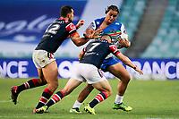 Leivaha Pulu takes on the defence. Sydney Roosters v Vodafone Warriors, NRL Rugby League. Allianz Stadium, Sydney, Australia. 31st March 2018. Copyright Photo: David Neilson / www.photosport.nz