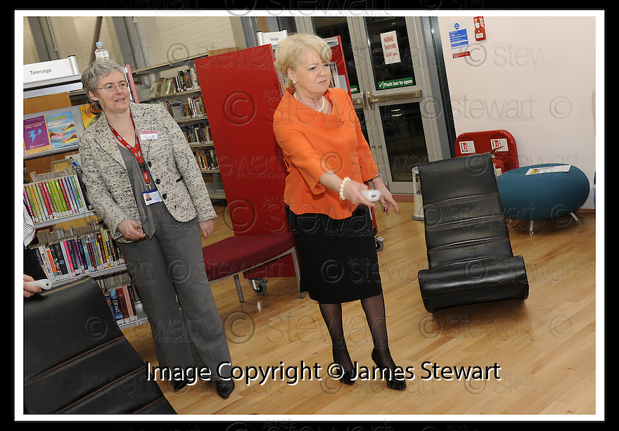 20/03/2009  Copyright Pic: James Stewart.File Name : 50_meadowbank.MEADOWBANK LIBRARY OFFICIAL OPENING.GUESTS HAVE FUN ON THE NINTENDO Wii.James Stewart Photography 19 Carronlea Drive, Falkirk. FK2 8DN      Vat Reg No. 607 6932 25.Telephone      : +44 (0)1324 570291 .Mobile              : +44 (0)7721 416997.E-mail  :  jim@jspa.co.uk.If you require further information then contact Jim Stewart on any of the numbers above.........