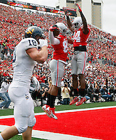 Ohio State Buckeyes tight end Marcus Baugh (85) celebrates his touchdown with Ohio State Buckeyes wide receiver Corey Smith (84) against Kent State Golden Flashes in the 2nd quarter of their game in Ohio Stadium on September 13, 2014.  (Dispatch photo by Kyle Robertson)