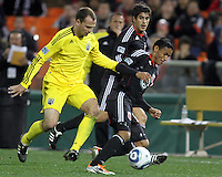 Andy Najar#14 of D.C. United moves away from Rich Balchan#2 of the Columbus Crew during the opening match of the 2011 season at RFK Stadium, in Washington D.C. on March 19 2011.D.C. United won 3-1.
