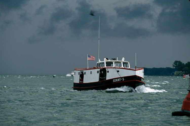 The ferry the Sonny S is returning to Put-in-Bay from Lonz Winery on Middle Bass Island. The conditions are rough with white caps,typical Lake Erie or Great Lakes Weather.