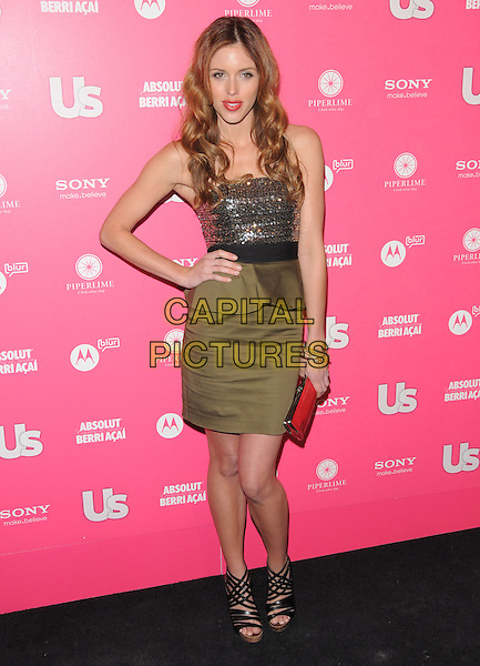 KAYLA EWELL.The Annual US Weekly Hot Hollywood Style Party at Drai's in Hollywood, California, USA..April 22nd, 2010                                                                    .full length peplum green skirt top dress silver top hand on hip red clutch bag sequins sequined strappy black sandals.CAP/RKE/DVS.©DVS/RockinExposures/Capital Pictures.