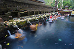 Balinese people in holy spring water in the sacred pool at Pura Tirta Empul Temple, Tampaksiring, Bali, Indonesia, Southeast Asia, Asia