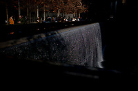 Waters flow in the World Trade Center memorial on Saturday, April 5, 2014, in New York. Pictured is the base of the former South Tower, which was destroyed by terrorists on Sept. 11, 2001. (Photo by James Brosher)