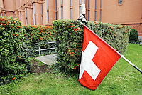 Switzerland. Canton of Neuchâtel. Neuchâtel. Grape Harvest Festival. Swis flag and a helmet with a feather. © 2006 Didier Ruef