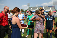 Cary, North Carolina  - Saturday April 29, 2017: Jessica McDonald hugs Alex Sahlen during a pregame ceremony honoring the Western New York Flash for winning the 2016 NWSL championship prior to regular season National Women's Soccer League (NWSL) match between the North Carolina Courage and the Orlando Pride at Sahlen's Stadium at WakeMed Soccer Park.