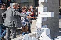 """Am Dienstag, den 5. September 2017, brachten Politiker und Passanten auf dem Berliner Gendarmenmarkt symbolisch eine Mauer mit Hasskommentaren aus dem Internet zum Einsturz.<br /> Die Hilfsorganisation CARE hatte diese Aktion unter dem Motto #caredonthate organisiert, um Mauern in den Koepfen einzureissen, die das friedliches Zusammenleben bedrohen. """"Wir kennen sie alle: Kommentare voller Hass, die im Internet kursieren. Facebook-Posts, die Menschen diskriminieren, teils sogar Gewalt androhen. Wir alle wissen, das ist eine Minderheit. Deutschland steht nicht fuer Hass"""", so CARE.<br /> Links im Bild: Norbert Roettgen, Parlamentarischer Geschaeftsfuehrer der CDU/CSU-Bundestagsfraktion.<br /> 5.9.2017, Berlin<br /> Copyright: Christian-Ditsch.de<br /> [Inhaltsveraendernde Manipulation des Fotos nur nach ausdruecklicher Genehmigung des Fotografen. Vereinbarungen ueber Abtretung von Persoenlichkeitsrechten/Model Release der abgebildeten Person/Personen liegen nicht vor. NO MODEL RELEASE! Nur fuer Redaktionelle Zwecke. Don't publish without copyright Christian-Ditsch.de, Veroeffentlichung nur mit Fotografennennung, sowie gegen Honorar, MwSt. und Beleg. Konto: I N G - D i B a, IBAN DE58500105175400192269, BIC INGDDEFFXXX, Kontakt: post@christian-ditsch.de<br /> Bei der Bearbeitung der Dateiinformationen darf die Urheberkennzeichnung in den EXIF- und  IPTC-Daten nicht entfernt werden, diese sind in digitalen Medien nach §95c UrhG rechtlich geschuetzt. Der Urhebervermerk wird gemaess §13 UrhG verlangt.]"""