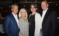 NWA Democrat-Gazette/CARIN SCHOPPMEYER William and Jane Douglas (from left) and Amy and Jeff Greer help support Big Brothers Big Sisters of Northwest Arkansas at the Big Event on Sept. 28 at the Barn at the Springs in Springdale.