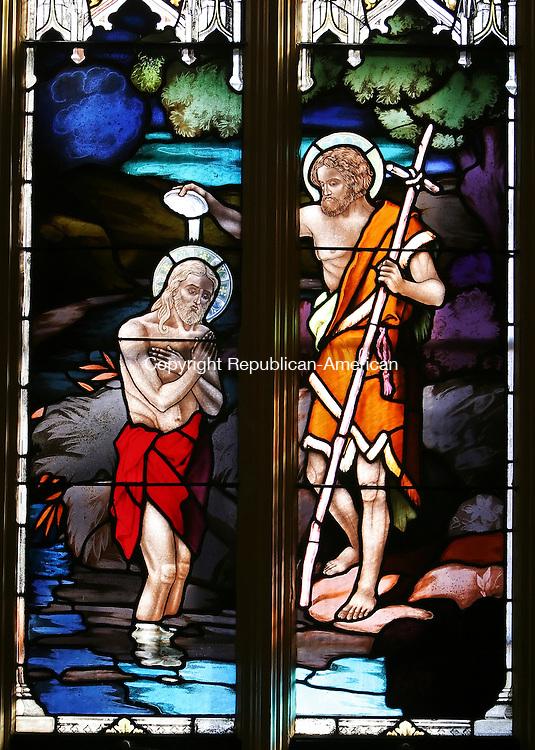 WATERBURY, CT 03/21/08- 032108BZ16- A stained glass window inside St. Francis Xavier Church on Baldwin Street in Waterbury depicts John baptizing Jesus. <br /> Jamison C. Bazinet Republican-American