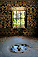 Water fountain inside a garden pavilion at the Alcazar of Seville, Seville, Andalusia, Spain.