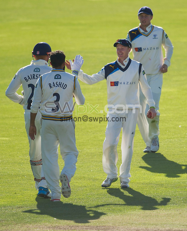 Picture by Allan McKenzie/SWpix.com - 26/09/2014 - Cricket - LV County Championship Div One - Yorkshire County Cricket Club v Somerset County Cricket Club - Headingley Cricket Ground, Leeds, England - Yorkshire's Jack Tattersall is congratulated on taking a catch to dismiss Somerset's Marcus Trescothick.