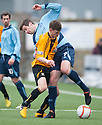 Alloa's Mitchel Megginson and Forfar's Chris Templeman challenge for the ball.