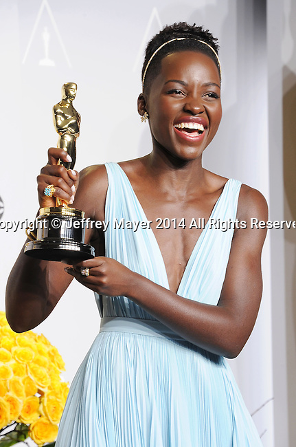 HOLLYWOOD, CA- MARCH 02: Actress Lupita Nyong'o poses in the press room during the 86th Annual Academy Awards at Loews Hollywood Hotel on March 2, 2014 in Hollywood, California.