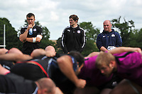 Bath academy forwards James Tyas and Tom Baldwin and Bristol prop Jason Hobson watch the scrummaging session from the sidelines. Bath Rugby training session on August 21, 2012 at Farleigh House in Bath, England. Photo by: Patrick Khachfe/Onside Images