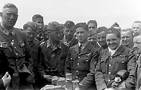 BNPS.co.uk (01202) 558833. <br /> Pic: LaurentViton/BNPS<br /> <br /> Captured pilots Sgt Edward Rodgers and, right, Sgt Cyril Bartlam with German soliders. <br /> <br /> An extraordinary photograph of two RAF airmen enjoying champagne and caviar with the charismatic German officer who had just captured them has been uncovered.<br /> <br /> The image shows the downed British servicemen with Panzer commander Hans von Luck.<br /> <br /> The German made a witty point of telling any captured Allied servicemen who fell into his hands that they were in luck as he was known to be a kindly officer who treated PoWs well.<br /> <br /> His hospitality seemed to even extend to rewarding the enemy with the luxuries of Nazi-occupied France.<br /> <br /> The remarkable colourised photograph has now been published in the British magazine Iron Cross.