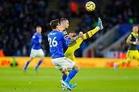 11th January 2020; King Power Stadium, Leicester, Midlands, England; English Premier League Football, Leicester City versus Southampton; Danny Ings of Southampton kicks the ball clear over his head under pressure from Dennis Praet of Leicester City - Strictly Editorial Use Only. No use with unauthorized audio, video, data, fixture lists, club/league logos or 'live' services. Online in-match use limited to 120 images, no video emulation. No use in betting, games or single club/league/player publications